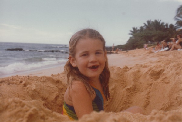 Peyton, 5, happily making a sandcastle at the beach