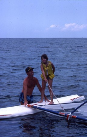 Peyton, 9, windsurfing with her dad