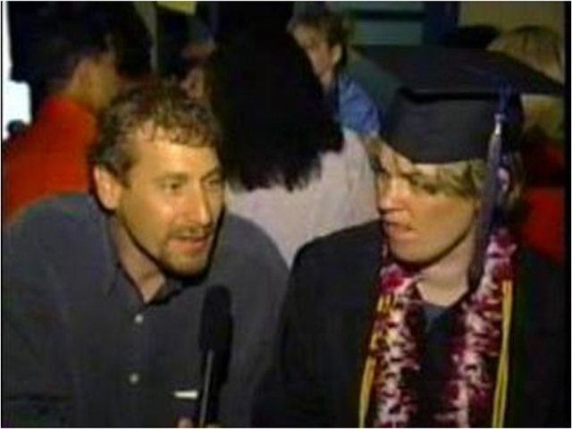 Peyton during her graduation celebration with Dr. Robert Friedman