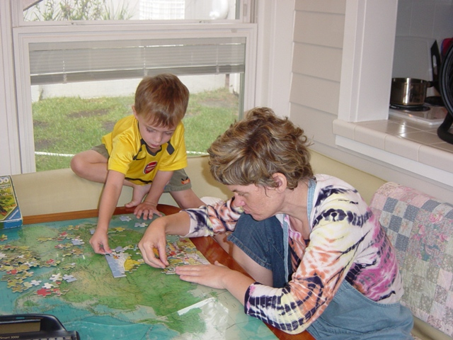 Peyton and Murray doing a puzzle together